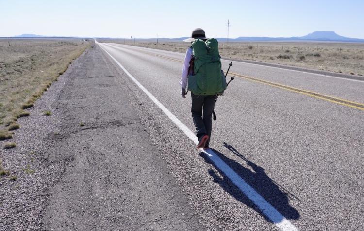 Walking Highway 60 into Pie Town, NM.