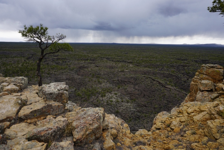 The view of thunderstorms from the Narrows Rim trail.