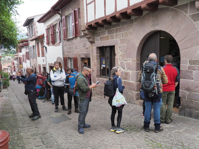 Waiting at the Pilgrim Office in Saint Jean Pied de Port, France.
